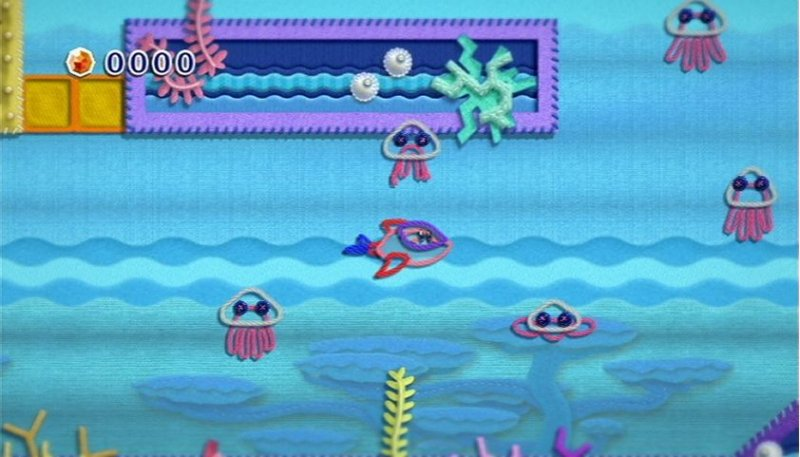 Kirby's Epic Yarn (WII)  © Nintendo 2010   4/9