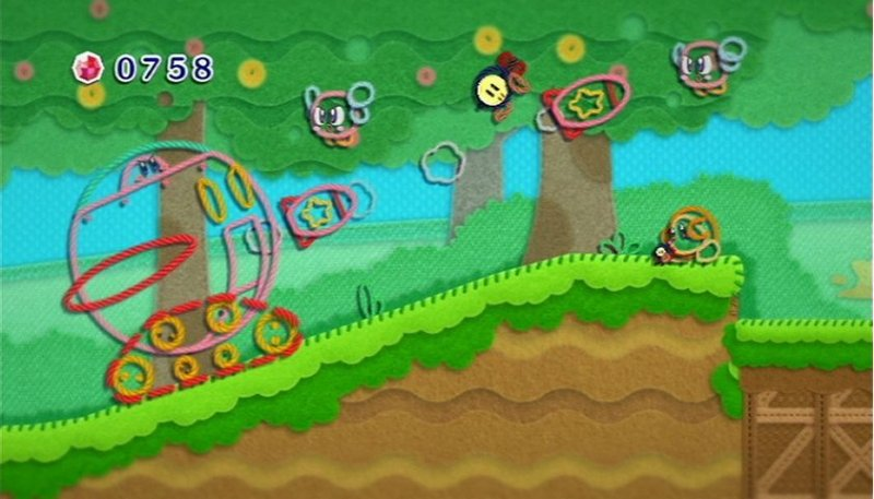 Kirby's Epic Yarn (WII)  © Nintendo 2010   6/9